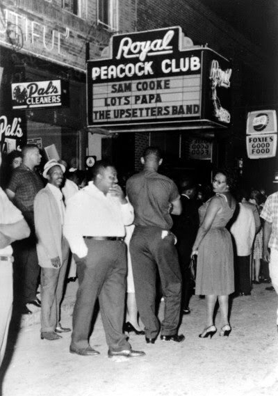 Crowds gather outside the famed Royal Peacock Club on Auburn Avenue in this photo from the 1960s. Originally named The Top Hat Club, the nightspot opened in 1938 and featured some of the top acts in show business, including Cab Calloway, Louis Armstrong, James Brown, Muddy Waters, Otis Redding, B.B. King, the Four Tops, Ray Charles, Sam Cooke, Wilson Pickett, The Supremes, Jackie Wilson, Little Richard, Aretha Franklin, Ike and Tina Turner and Gladys Knight and the Pips. The club, at 186 Auburn Avenue, reopened in 2010 and remains open today. Photo courtesy of Skip Mason Archives. Credit: AJC.